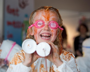 "Mackenzie, 6, gets messy in a giant kids food fight as part of the Persil ""Cook with the Kids Promise"", which is encouraging parents to get cooking with their kids. See SWNS story SWCOOK: Almost 90 per cent of parents avoid cooking with their children because they are worried about making a mess, according to a new study. Researchers found that 88 per cent of parents said cooking with their youngsters required too much clearing up.  Just under half of those interviewed said that they were simply too busy to clear up the mess made by their children in the kitchen. The study of 2,000 people, conducted by Persil Washing Up Liquid, discovered that only 12 per cent of adults weren't worried about making a mess when cooking with their children."